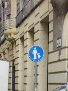 In this area, men in hats can walk holding hands with little girls.