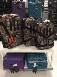 If you need three pieces of camouflage luggage, you're bringing too much while hunting.  (This statement applies to no one in particular)